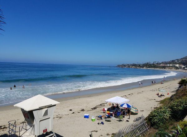 people enjoying sleepy hollow beach in laguna beach california