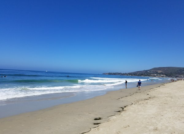 sand and pacific ocean at oak street beach laguna beach